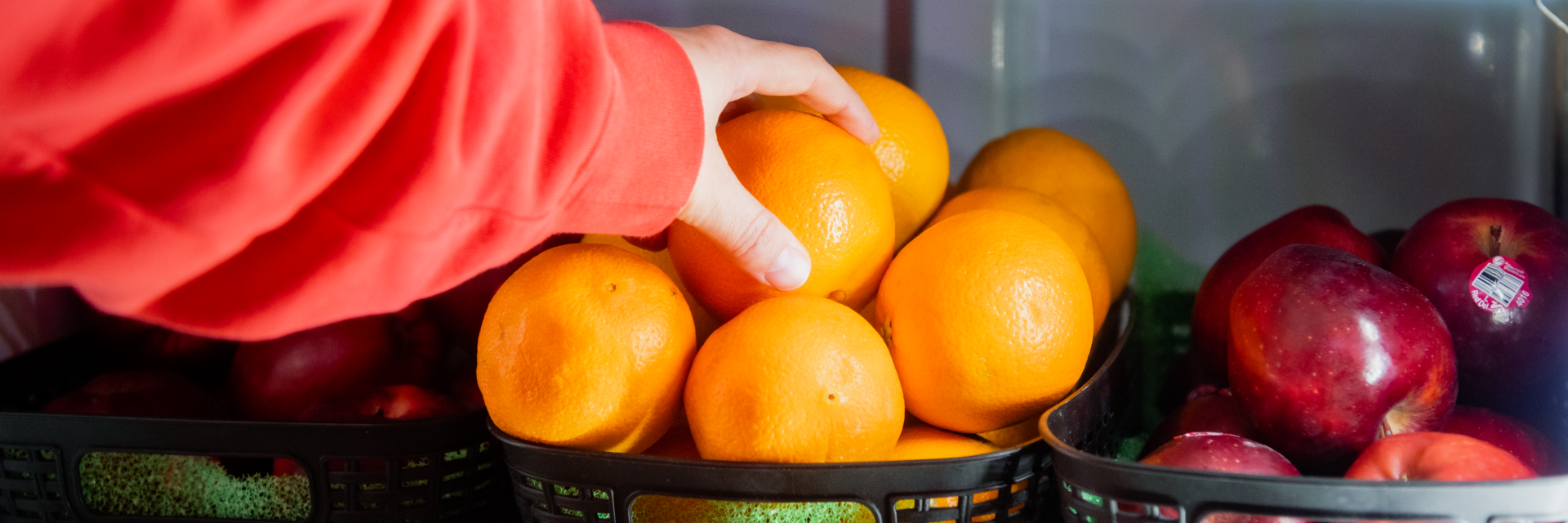 hand grabbing an orange